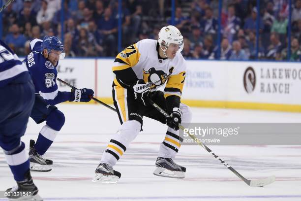 Pittsburgh Penguins center Evgeni Malkin skates the puck away from Tampa Bay Lightning center Steven Stamkos in the 3rd period of the NHL game...