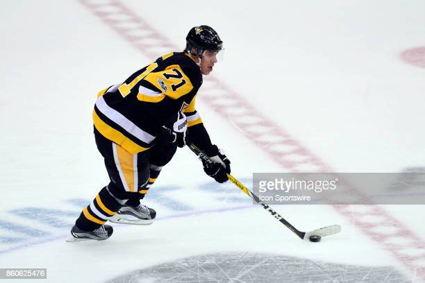 Pittsburgh Penguins center Evgeni Malkin skates the puck through center ice during the first period in the NHL game between the Pittsburgh Penguins...