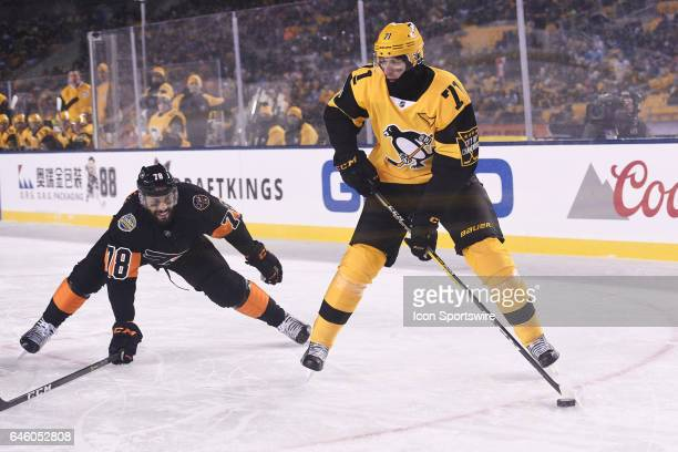 Pittsburgh Penguins Center Evgeni Malkin skates with the puck as Philadelphia Flyers Center PierreEdouard Bellemare defends during the second period...