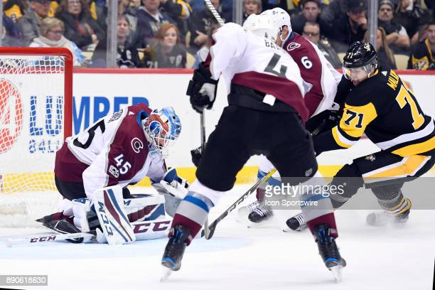 Pittsburgh Penguins Center Evgeni Malkin tries to jam the puck past Colorado Avalanche Goalie Jonathan Bernier as Colorado Avalanche Goalie Jonathan...