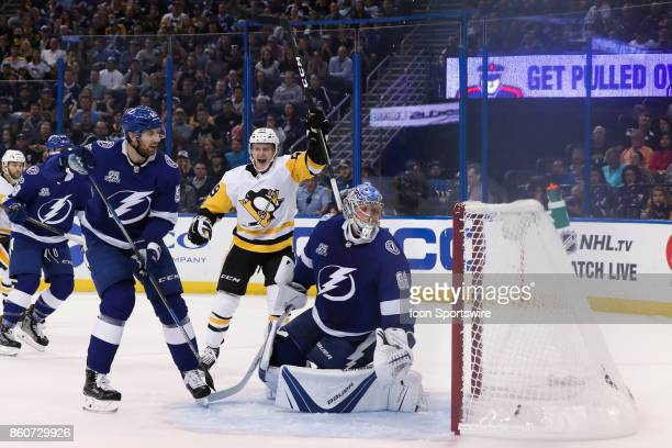 Pittsburgh Penguins center Jake Guentzel celebrates after scoring a goal on Tampa Bay Lightning goalie Andrei Vasilevskiy in the 1st period of the...