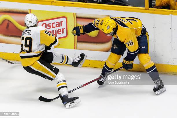 Pittsburgh Penguins center Jake Guentzel falls to the ice after check by Nashville Predators defenseman PK Subban during game 6 of the 2017 NHL...