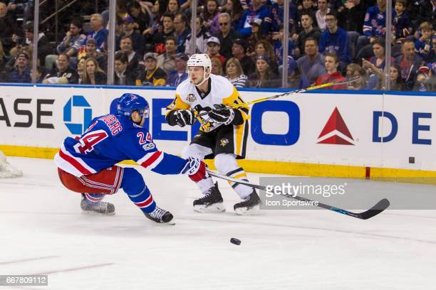 Pittsburgh Penguins Center Kevin Porter flips the puck past New York Rangers Center Oscar Lindberg during the first period of the final game of the...