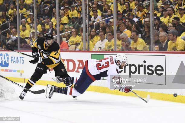 Pittsburgh Penguins Center Matt Cullen checks Washington Capitals right wing Tom Wilson as he moves the puck during the first period in Game Six of...