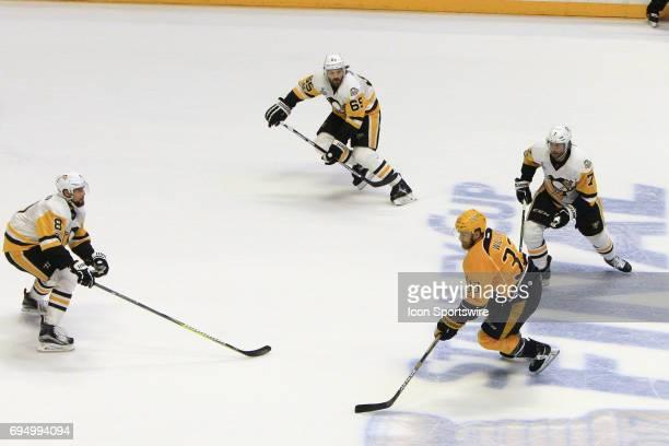 Pittsburgh Penguins center Matt Cullen Pittsburgh Penguins defenseman Ron Hainsey and Pittsburgh Penguins defenseman Brian Dumoulin defend against...