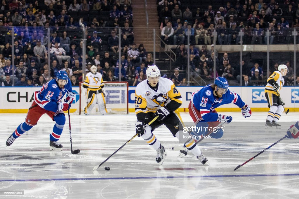 Pittsburgh Penguins Center Oskar Sundqvist (40) takes the puck into the Rangers zone during the third period of the final game of the regular season between the Pittsburgh Penguins and the New York Rangers on April 09, 2017, at Madison Square Garden in New York, NY.