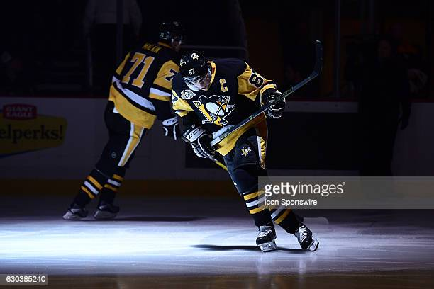 Pittsburgh Penguins Center Sidney Crosby and Pittsburgh Penguins Center Evgeni Malkin take the ice before the first period in the NHL game between...