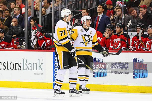 Pittsburgh Penguins center Sidney Crosby and Pittsburgh Penguins center Evgeni Malkin during the first period of the National Hockey League game...