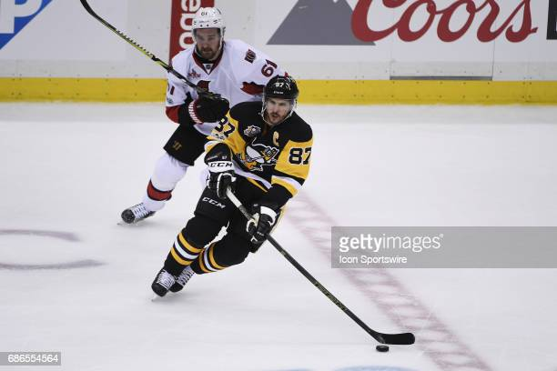 Pittsburgh Penguins Center Sidney Crosby passes the puck as Ottawa Senators right wing Mark Stone defends during the second period in Game Five of...
