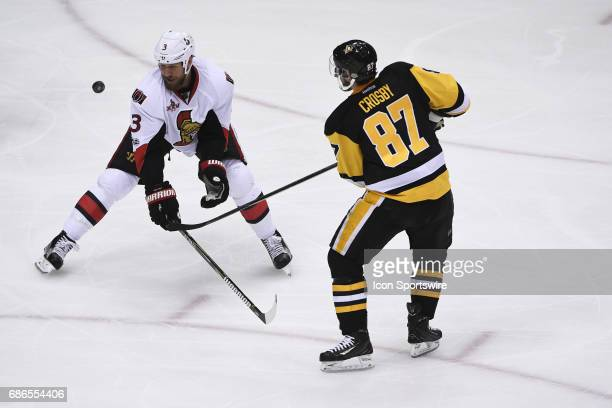 Pittsburgh Penguins Center Sidney Crosby shoots the puck past Ottawa Senators defenseman Marc Methot during the second period in Game Five of the...