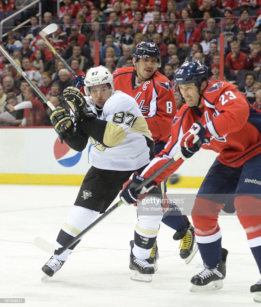 Pittsburgh Penguins center Sidney Crosby (87)skates against Washington Capitals right wing Alex Ovechkin (8) and defenseman Tyson Strachan (23) during second period action on November, 20, 2013 in Washington, DC.
