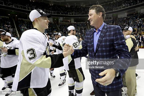 Pittsburgh Penguins Coowner and Chairman Mario Lemieux celebrates with Olli Maatta after their 31 victory to win the Stanley Cup against the San Jose...