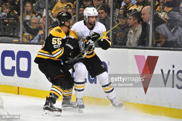 Pittsburgh Penguins Defenceman Brian Dumoulin braces for the hit from Boston Bruins Right Wing Noel Acciari During the Pittsburgh Penguins game...