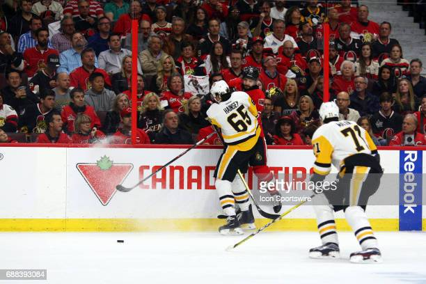 Pittsburgh Penguins Defenceman Ron Hainsey with a hit on Ottawa Senators Left Wing Clarke MacArthur during the first period of Game 6 of the Eastern...