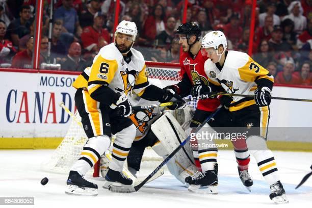 Pittsburgh Penguins Defenceman Trevor Daley Pittsburgh Penguins Defenceman Olli Maatta and Ottawa Senators Center JeanGabriel Pageau watch a shot...