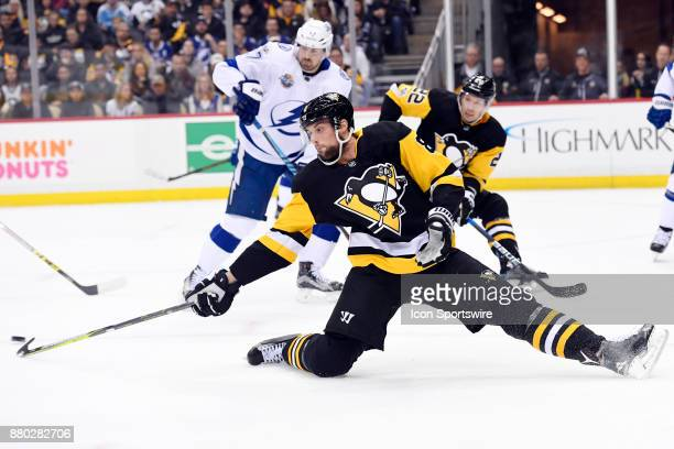 Pittsburgh Penguins Defenseman Brian Dumoulin defends a shot during the first period in the NHL game between the Pittsburgh Penguins and the Tampa...