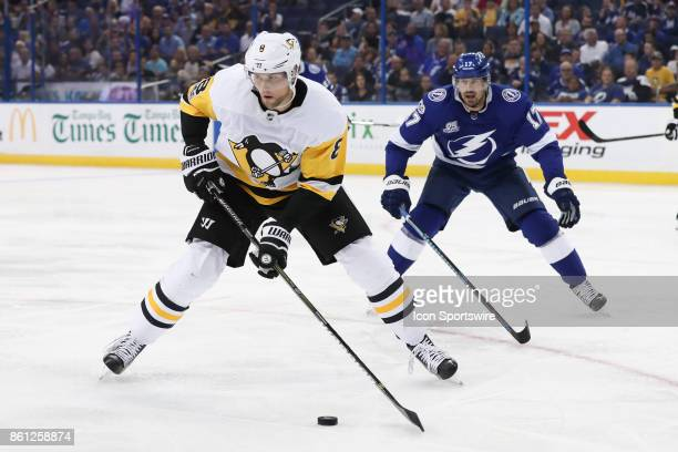 Pittsburgh Penguins defenseman Brian Dumoulin skates the puck away from Tampa Bay Lightning left wing Alex Killorn in the 2nd period of the NHL game...