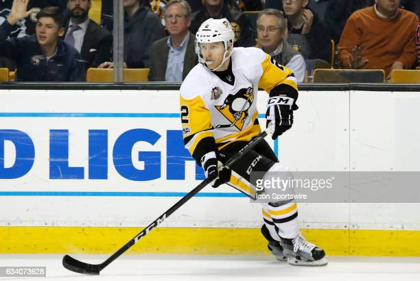 Pittsburgh Penguins defenseman Chad Ruhwedel cycles with the puck during a regular season NHL game between the Boston Bruins and the Pittsburgh...