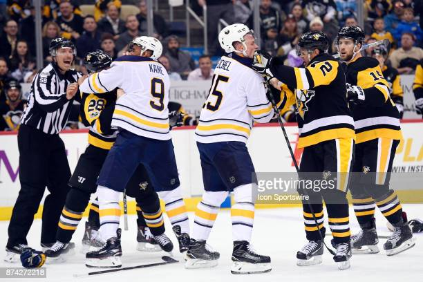 Pittsburgh Penguins Defenseman Ian Cole and Buffalo Sabres Left Wing Evander Kane along with Pittsburgh Penguins Right Wing Patric Hornqvist and...