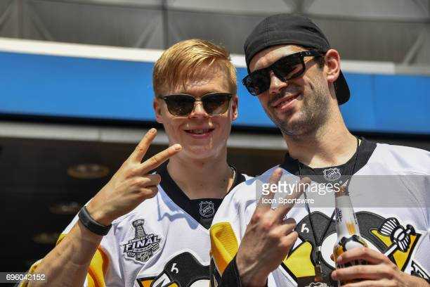 Pittsburgh Penguins defenseman Olli Maatta and defenseman Justin Schultz hold up two fingers as they celebrate backtoback Stanley Cup Championships...