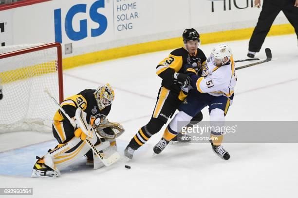 Pittsburgh Penguins defenseman Olli Maatta defends against Nashville Predators left wing Austin Watson while Pittsburgh Penguins goalie Matt Murray...