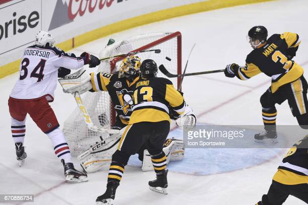 Pittsburgh Penguins Defenseman Olli Maatta saves the puck from going into the net on a shot by Columbus Blue Jackets right wing Josh Anderson as...