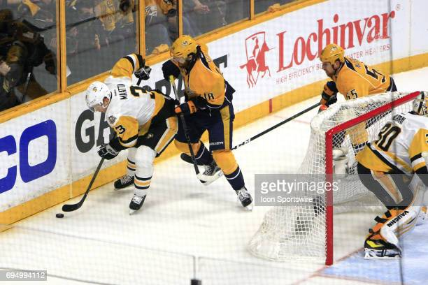 Pittsburgh Penguins defenseman Olli Maatta shields the puck from Nashville Predators right wing James Neal during Game 6 of the Stanley Cup Final...