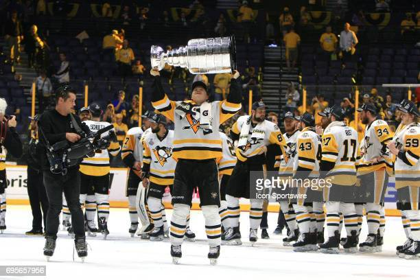Pittsburgh Penguins defenseman Olli Maatta skates with the Stanley Cup following Game 6 of the Stanley Cup Final between the Nashville Predators and...