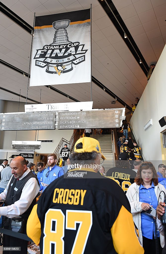 A Pittsburgh Penguins fan waits under a Stanley Cup Final banner prior to Game One of the 2016 NHL Stanley Cup Final between the San Jose Sharks and the Pittsburgh Penguins at Consol Energy Center on May 30, 2016 in Pittsburgh, Pennsylvania.