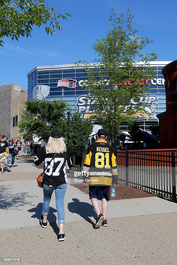 Pittsburgh Penguins fans walk outside of the arena prior to Game One of the 2016 NHL Stanley Cup Final between the San Jose Sharks and the Pittsburgh Penguins at Consol Energy Center on May 30, 2016 in Pittsburgh, Pennsylvania.