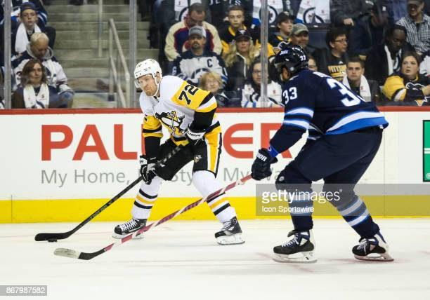 Pittsburgh Penguins forward Patric Hornqvist looks to make a pass during the NHL game between the Winnipeg Jets and the Pittsburgh Penguins on...