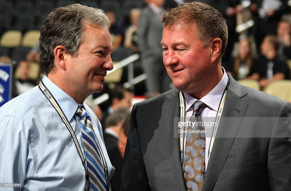 Pittsburgh Penguins general manager Ray Shero talks with Vancouver Canucks general manager Mike Gillis during day two of the 2012 NHL Entry Draft at Consol Energy Center on June 23, 2012 in Pittsburgh, Pennsylvania.