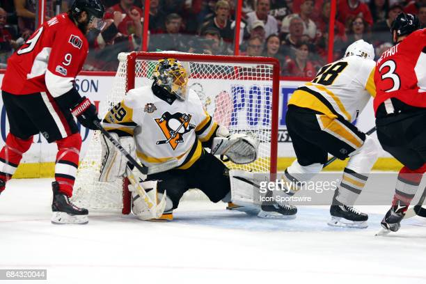 Pittsburgh Penguins Goalie MarcAndre Fleury gets beat by Ottawa Senators Defenceman Marc Methot during the first period in Game 3 of the Eastern...