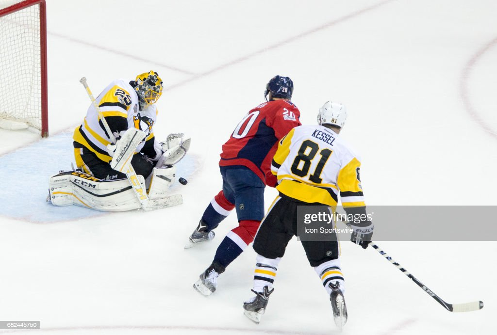 Pittsburgh Penguins goalie Marc-Andre Fleury (29) saves a shot from Washington Capitals center Lars Eller (20) during game 7 of the Stanley Cup Eastern Conference semifinal between the Washington Capitals and the Pittsburgh Penguins on May 10, 2017, at the Verizon Center in Washington DC. Pittsburgh defeated the Washington Capitals 2-0.