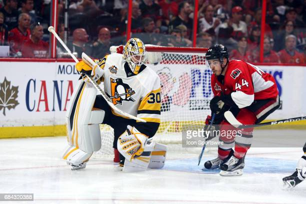 Pittsburgh Penguins Goalie Matt Murray keeps an eye on Ottawa Senators Center JeanGabriel Pageau after making a save in the third period of Game 3 of...