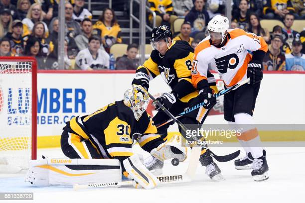Pittsburgh Penguins Goalie Matt Murray makes a glove save on Philadelphia Flyers Right Wing Wayne Simmonds in front as Pittsburgh Penguins Defenseman...