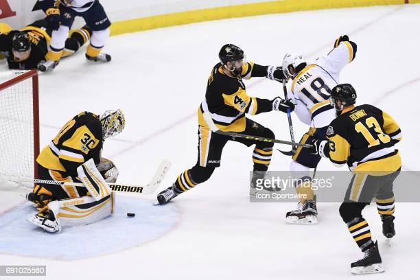 Pittsburgh Penguins goalie Matt Murray makes a save on Nashville Predators left wing James Neal in front as Pittsburgh Penguins defenseman Justin...