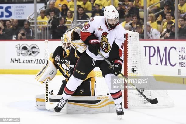 Pittsburgh Penguins Goalie Matt Murray tends net as Ottawa Senators left wing Clarke MacArthur looks to deflect the puck in front of the net during...