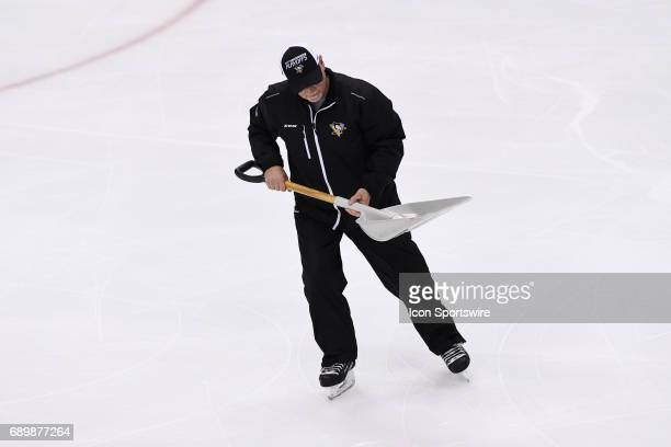 Pittsburgh Penguins ice crew removes a catfish from the ice during the second period in Game One of the 2017 NHL Stanley Cup Final between the...