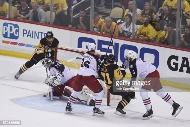 Pittsburgh Penguins Left Wing Bryan Rust tires a wraparound as Columbus Blue Jackets goalie Sergei Bobrovsky while Columbus Blue Jackets defenseman...
