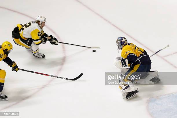 Pittsburgh Penguins left wing Carl Hagelin prepares to shoot against Nashville Predators goalie Pekka Rinne as Nashville Predators defenseman PK...