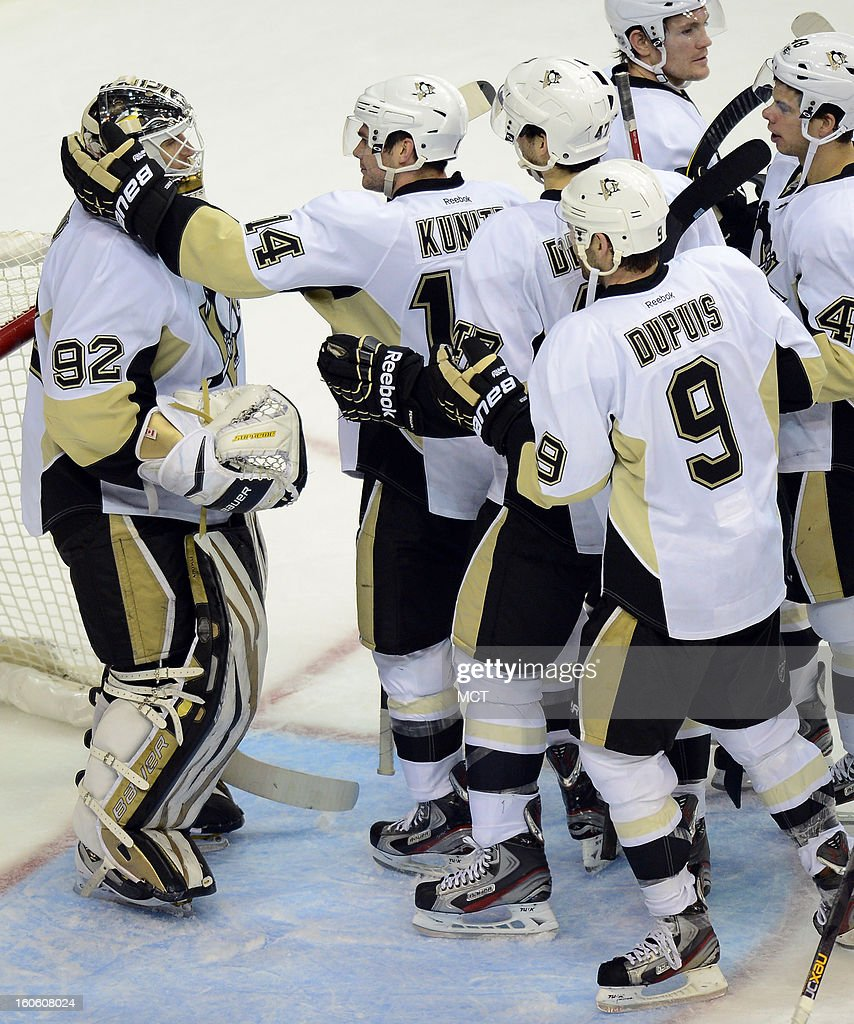 Pittsburgh Penguins left wing Chris Kunitz (14) congratulates Penguins goalie Tomas Vokoun (92) following a 6-3 victory over the Washington Capitals at the Verizon Center in Washington, D.C., Sunday, February 3, 2013. Kunitz had a hat trick in the game.