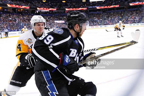 Pittsburgh Penguins left wing Chris Kunitz gets ready to check Tampa Bay Lightning defenseman Nikita Nesterov into the glass in the second period of...