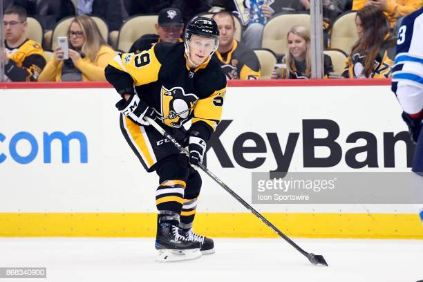 Pittsburgh Penguins Left Wing Jake Guentzel handles the puck during the overtime period in the NHL game between the Pittsburgh Penguins and the...