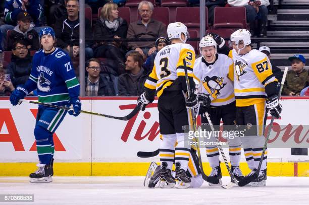 Pittsburgh Penguins Left Wing Jake Guentzel is congratulated after scoring a goal against the Vancouver Canucks during their NHL game at Rogers Arena...