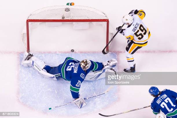 Pittsburgh Penguins Left Wing Jake Guentzel scores a goal on Vancouver Canucks Goalie Jacob Markstrom during their NHL game at Rogers Arena on...