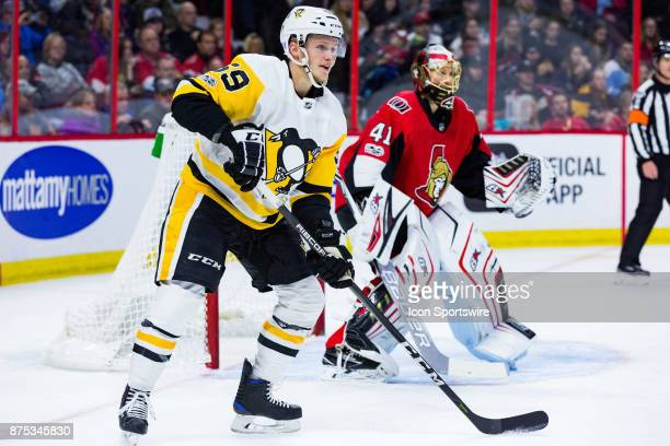 Pittsburgh Penguins Left Wing Jake Guentzel sets up next to Ottawa Senators Goalie Craig Anderson during first period National Hockey League action...