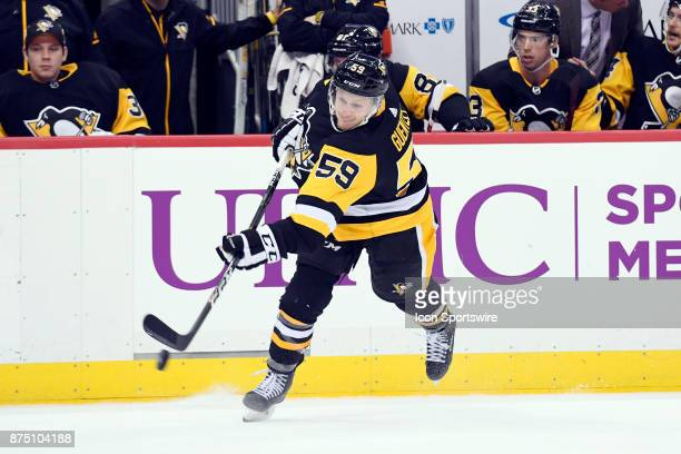 Pittsburgh Penguins Left Wing Jake Guentzel shoots the puck during the second period in the NHL game between the Pittsburgh Penguins and the Buffalo...