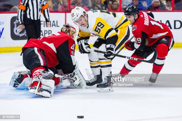 Pittsburgh Penguins Left Wing Jake Guentzel watches a rebound slip away from him in front of Ottawa Senators Goalie Craig Anderson during first...