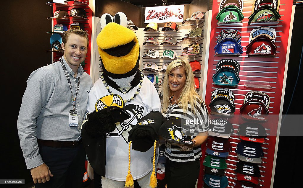 Pittsburgh Penguins mascot Iceburgh poses with Kevin Sloan and Inger Olson of Zephyr Headwear during 2013 NHL Exchange the annual NHL Licensed Products forum at the Consol Energy Center on July 30, 2013 in Pittsburgh, Pennsylvania.